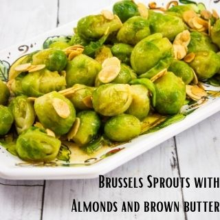 brussels sprouts with almonds and brown butter on a rectangular platter