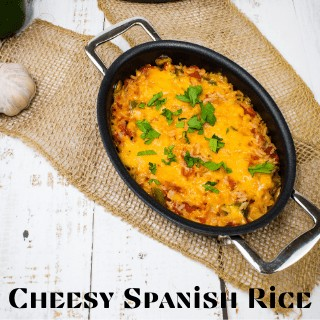 cheesy baked spanish rice in an oval serving container