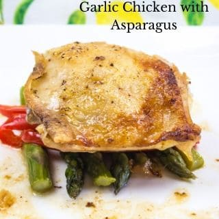 garlic chicken with asparagus on a square white plate