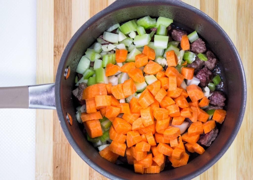 Carrots, celery and onion added to the beef in the pot.
