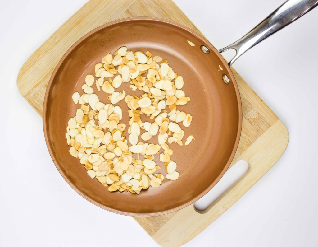 Toasting the almonds in a dry skillet.