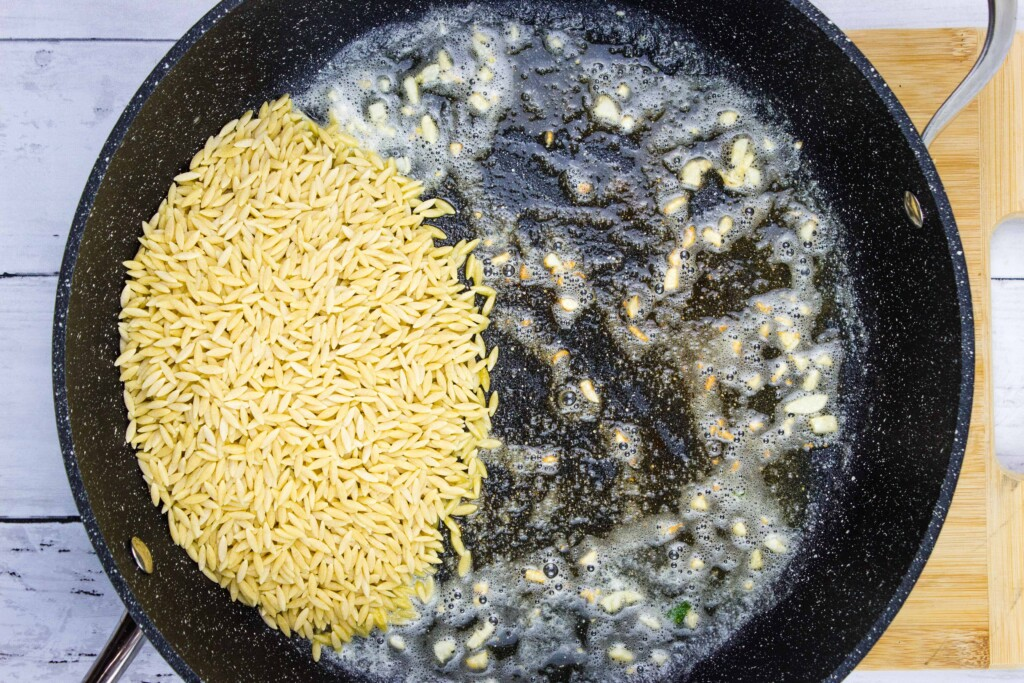 toasting the orzo in the skillet with the garlic butter