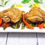 garlic chicken and asparagus on a white plate