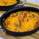 baked cheesy spanish rice in a small oval casserole dish
