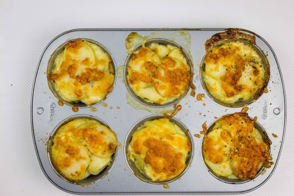 cheesy baked au gratin potatoes gruyere in the muffin pan