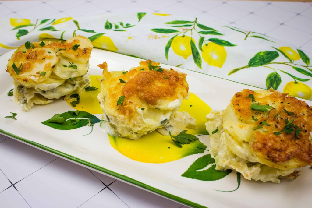 potatoes au gratin gruyere on a platter with a floral napkin