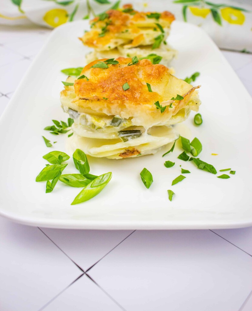 potatoes au gratin gruyere on a platter