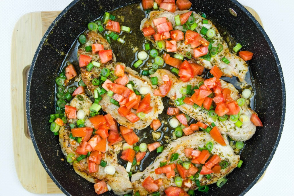the cooked pork chops topped with tomato and onion relish