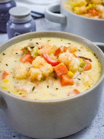 shrimp & corn chowder with chipotle in a bowl with a second serving in the background