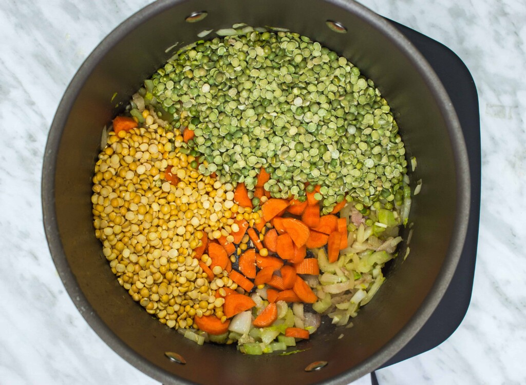 Add the dried peas, kale, carrots, and broth.