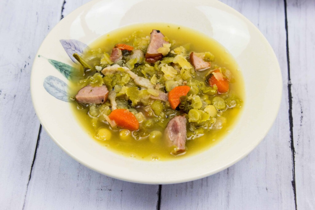 split pea, ham and sausage soup in a bowl