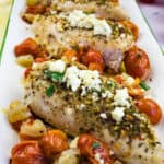 a closeup of mediterranean chicken bake with feta and tomatoes