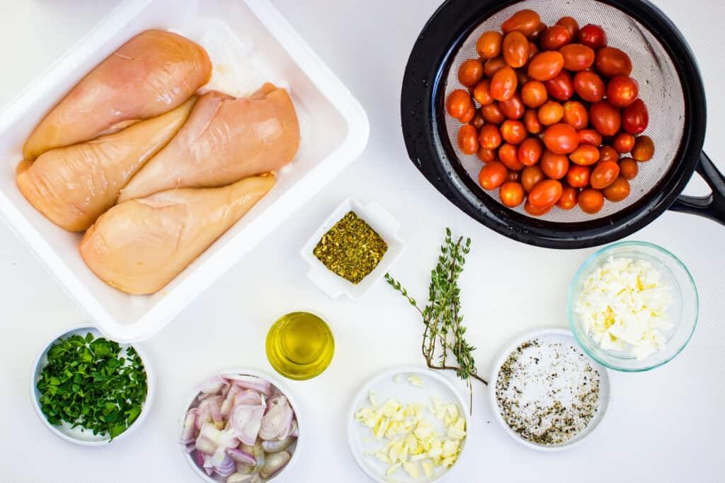Prepped ingredients for mediterranean chicken bake.