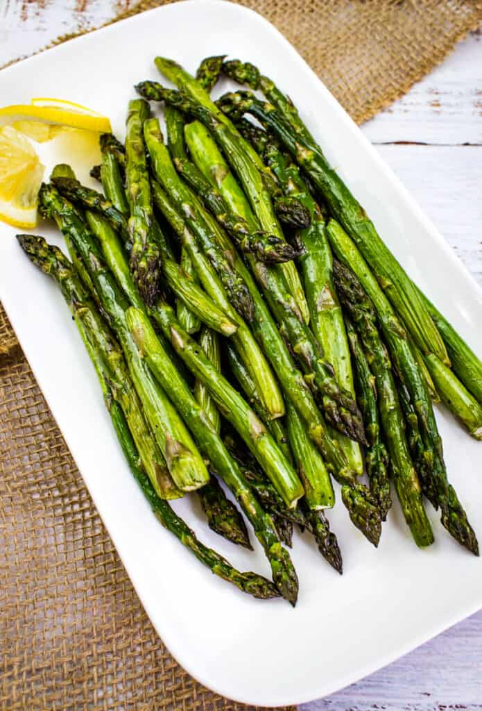 smoked asparagus on a white serving plate