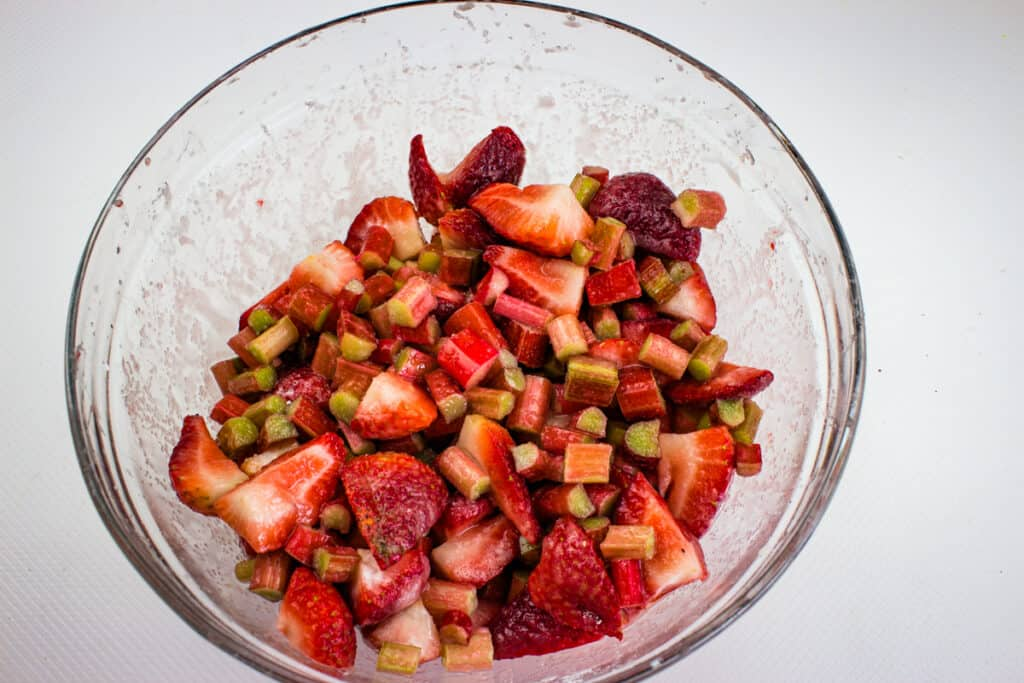 mix the fruit and rhubarb with cornstarch, lemon and sugar