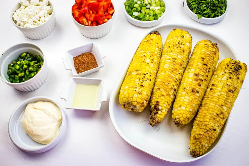 Prepped ingredients to make easy street corn salad recipe