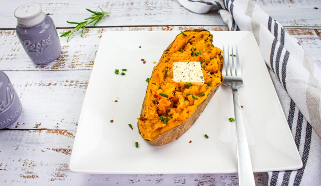 baked sweet potato air fryer on a square plate