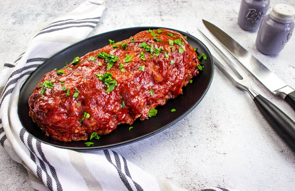 smoked meatloaf recipe on a black plate