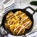 corn fritters in a black serving dish