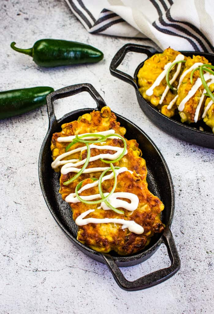 easy corn fritters in a black serving dish