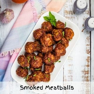 smoked meatballs on a white plate