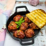 smoked meatballs in a black dish