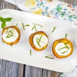 smoked peaches with spice rum whipped cream on a platter