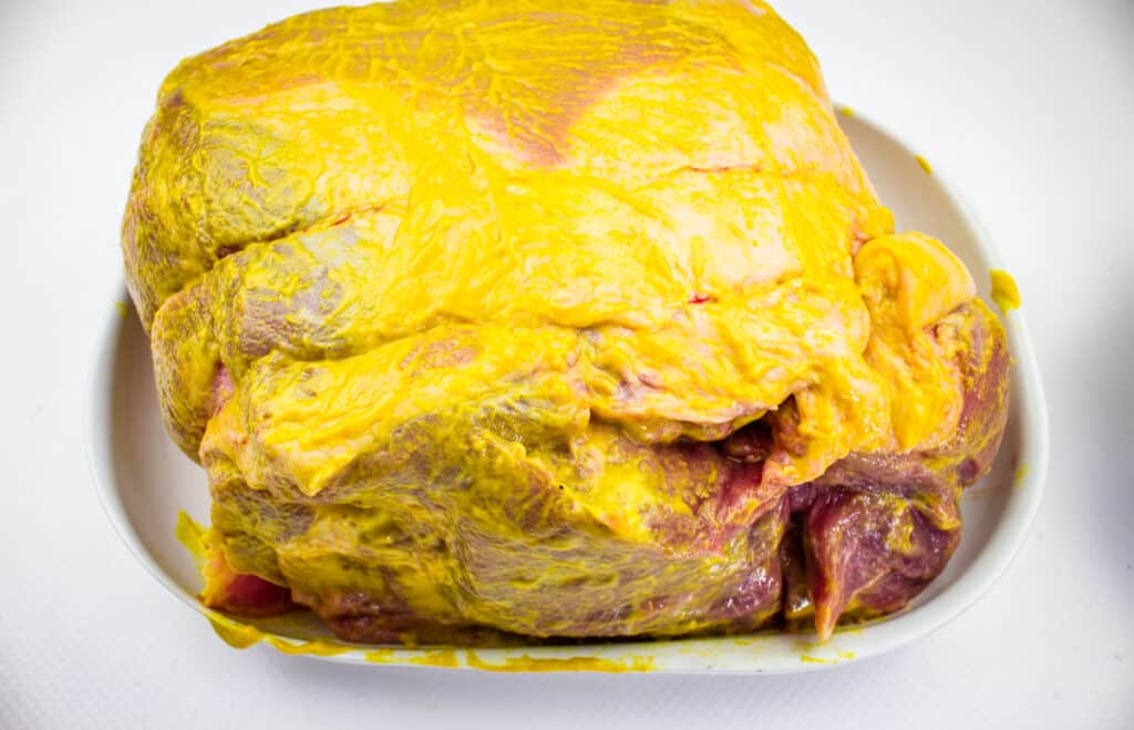 pork butt rubbed with mustard