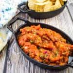 smoked tomato salsa in a black dish