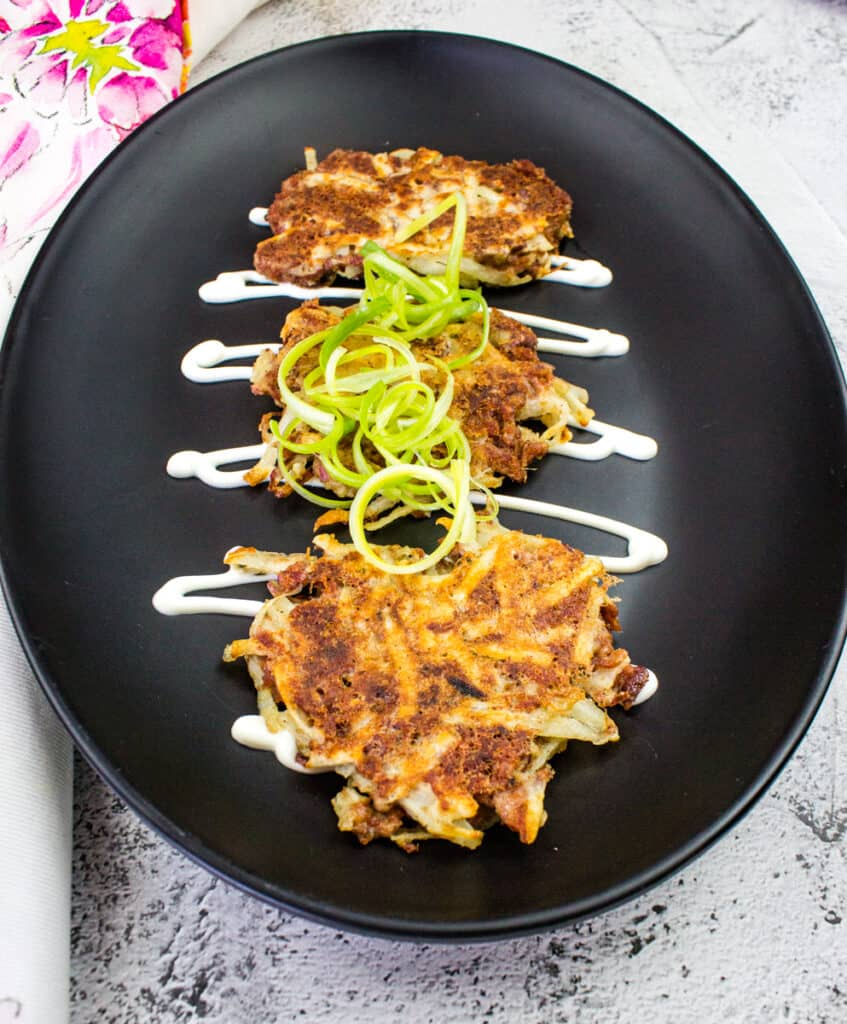 corned beef fritters on a black plate