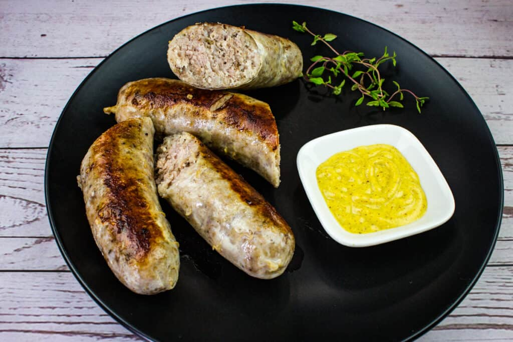 sausage sous vide on a plate with mustard