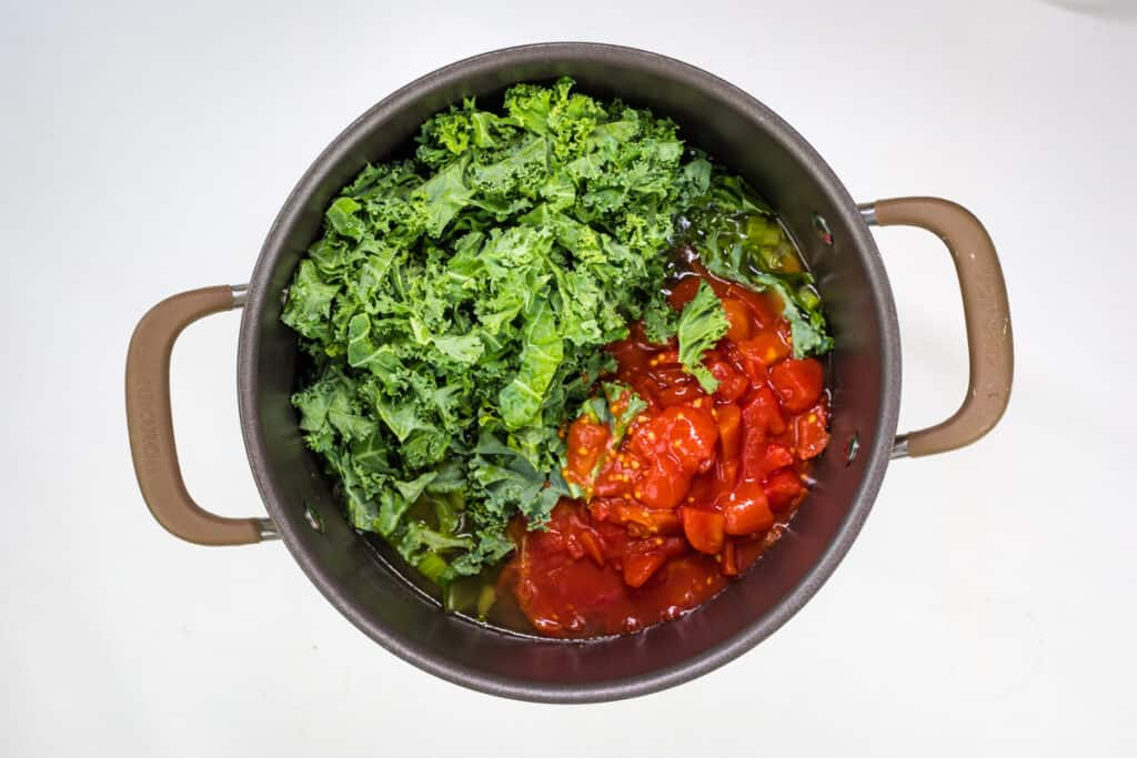 add kale, tomatoes, and broth to the pot