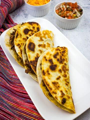 tacos dorados on a plate