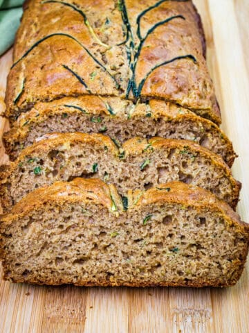 sliced zucchini bread on a cutting board